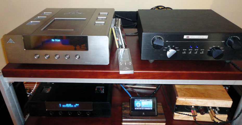 (Left upper and lower) AMR CD-77 CD Player and DP-777 DAC; (right upper and lower) First Sound Paramount MKIII Preamplifier and crossover for Daedalus BOW subwoofers
