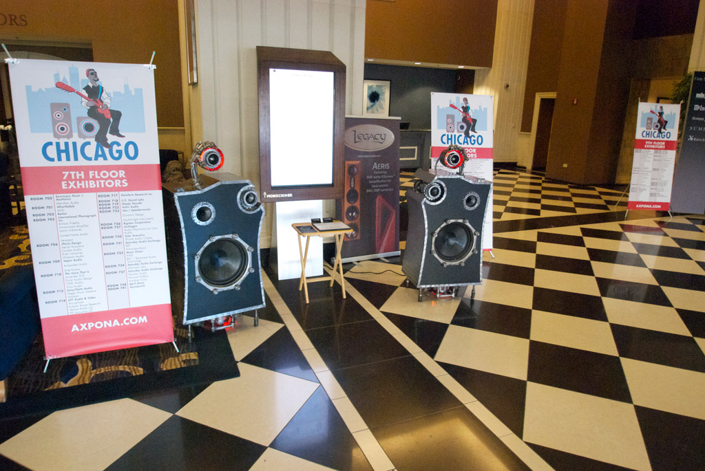 Axpona 2013 Entrance with Man Cave speakers